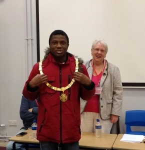 Year-13-student-Amir-Norris-trying-on-the-Mayoral-Chain,-along-with-the-Mayor-Cllr-Mrs-Jean-Dent